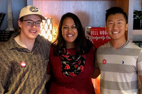Wisconsin in Washington program alumn Purnita Howlander standing next to two men