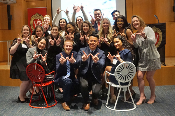 Wisconsin in Washington program students next to terrace chairs