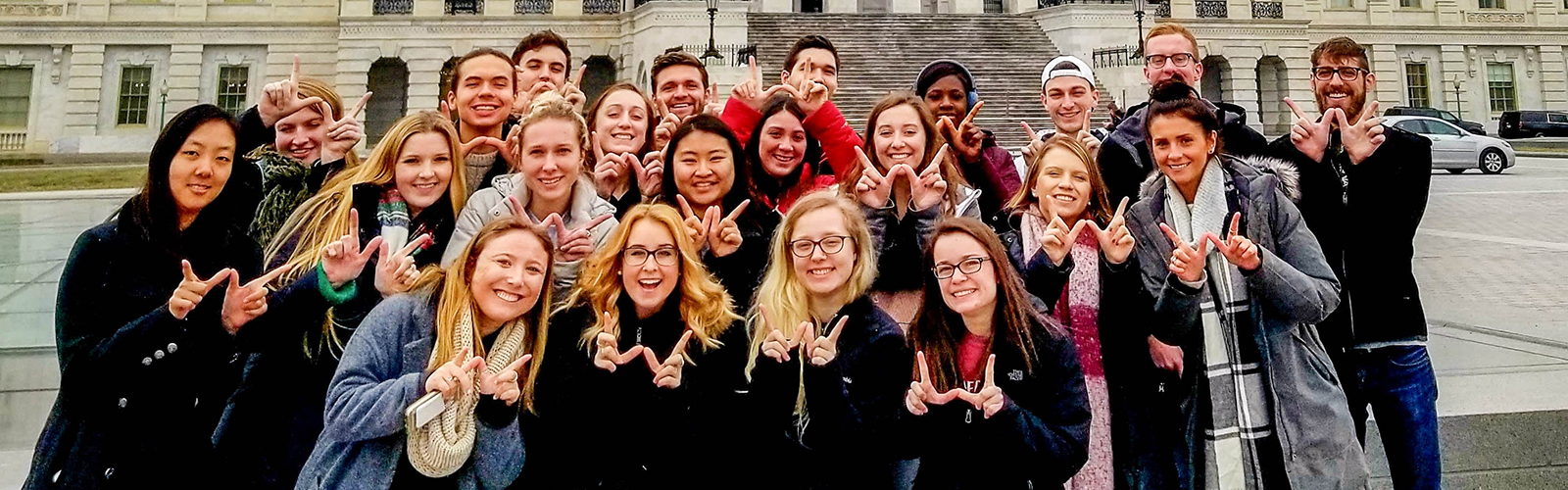 Wisconsin in Washington Students flash Finger W's in front of the US capitol building
