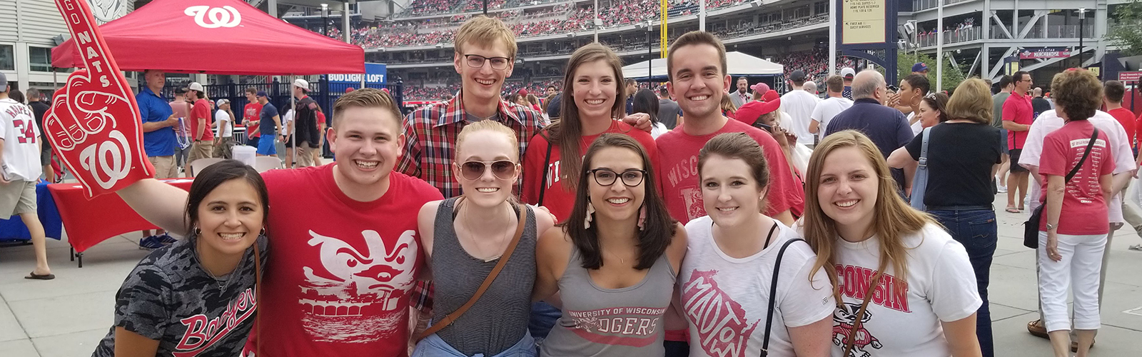 Wisconsin in Washington students wearing Badger gear at sporting event